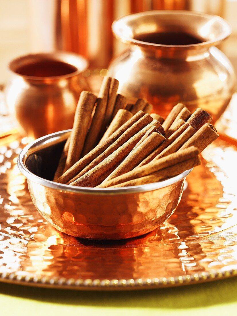 Cinnamon sticks in copper bowl