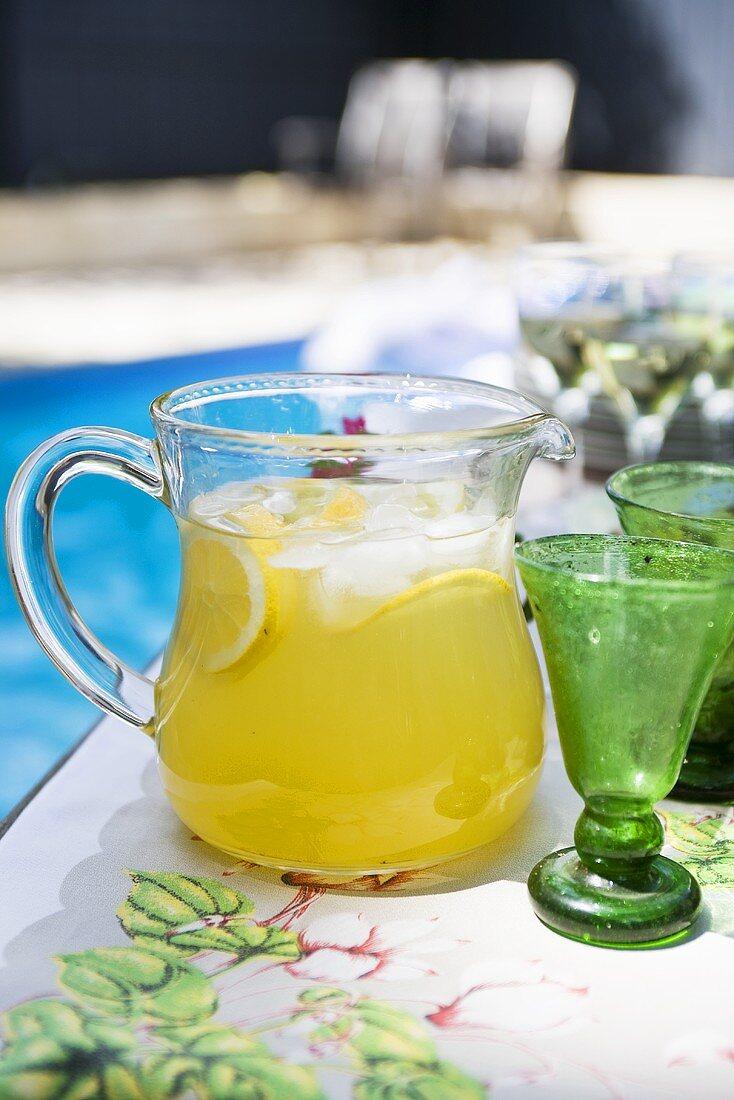 Lemonade in a jug by a pool