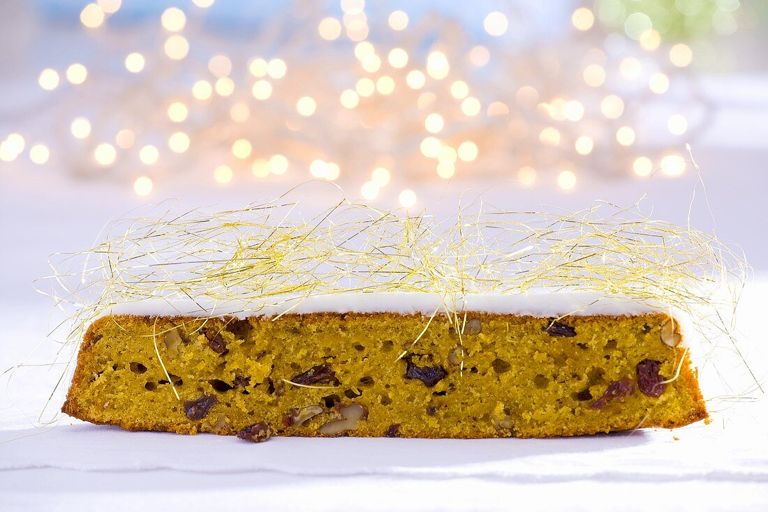 Iced nut & raisin cake with caramel strands for Christmas