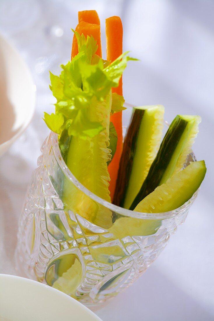 Cucumber sticks and carrot sticks in a glass