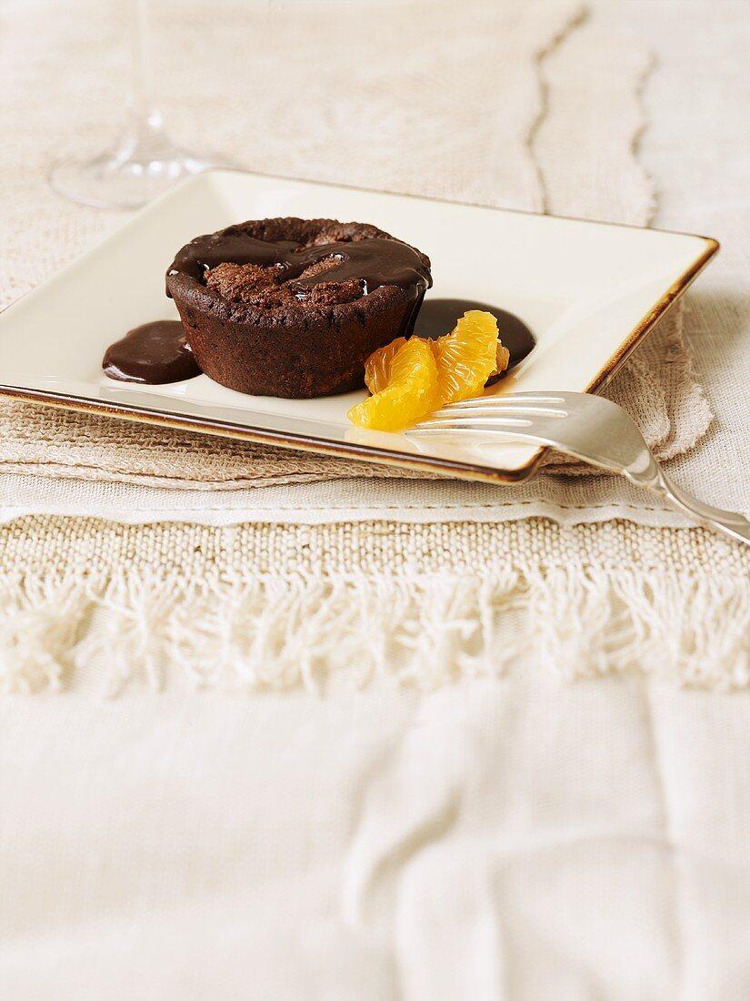 Warm chocolate ricotta pudding with mandarin orange segments