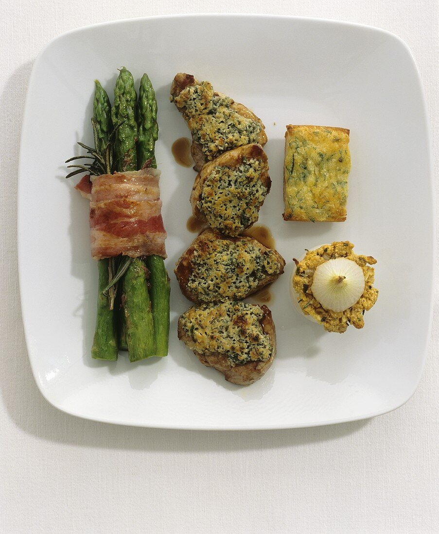 Pork fillet with herb crust and assorted accompaniments