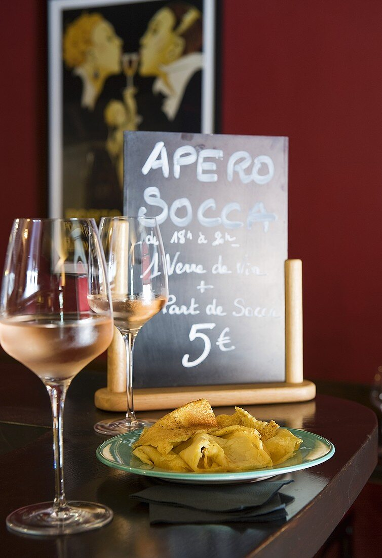 Wine and socca (chickpea pancake from Nice) in a restaurant