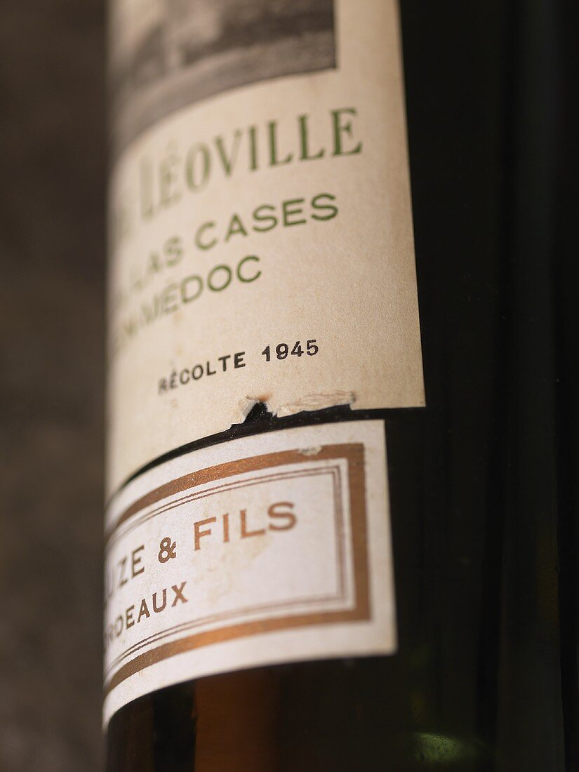 A bottle of red wine with a label (Leoville-las-Cases)