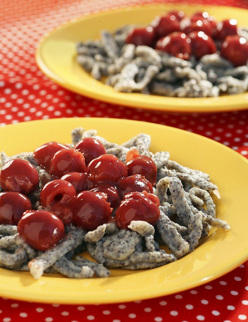 Poppyseed Spätzle (soft egg noodles from Swabia) with hot cherries