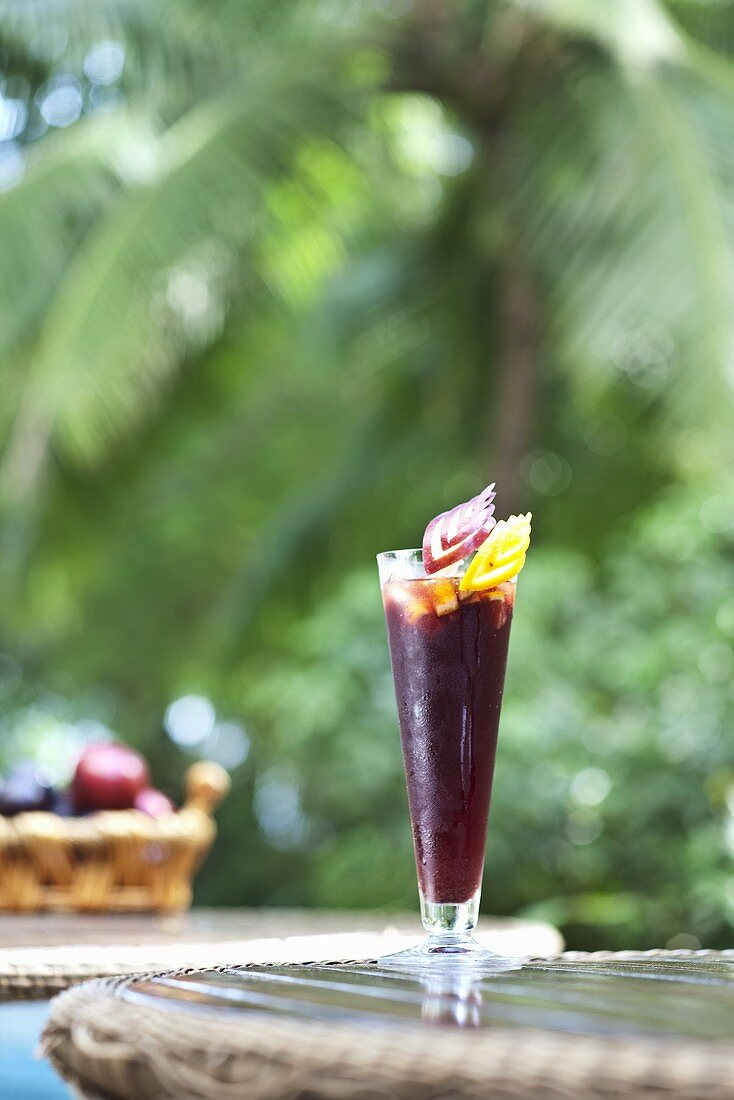 A glass of sangria on a bistro table