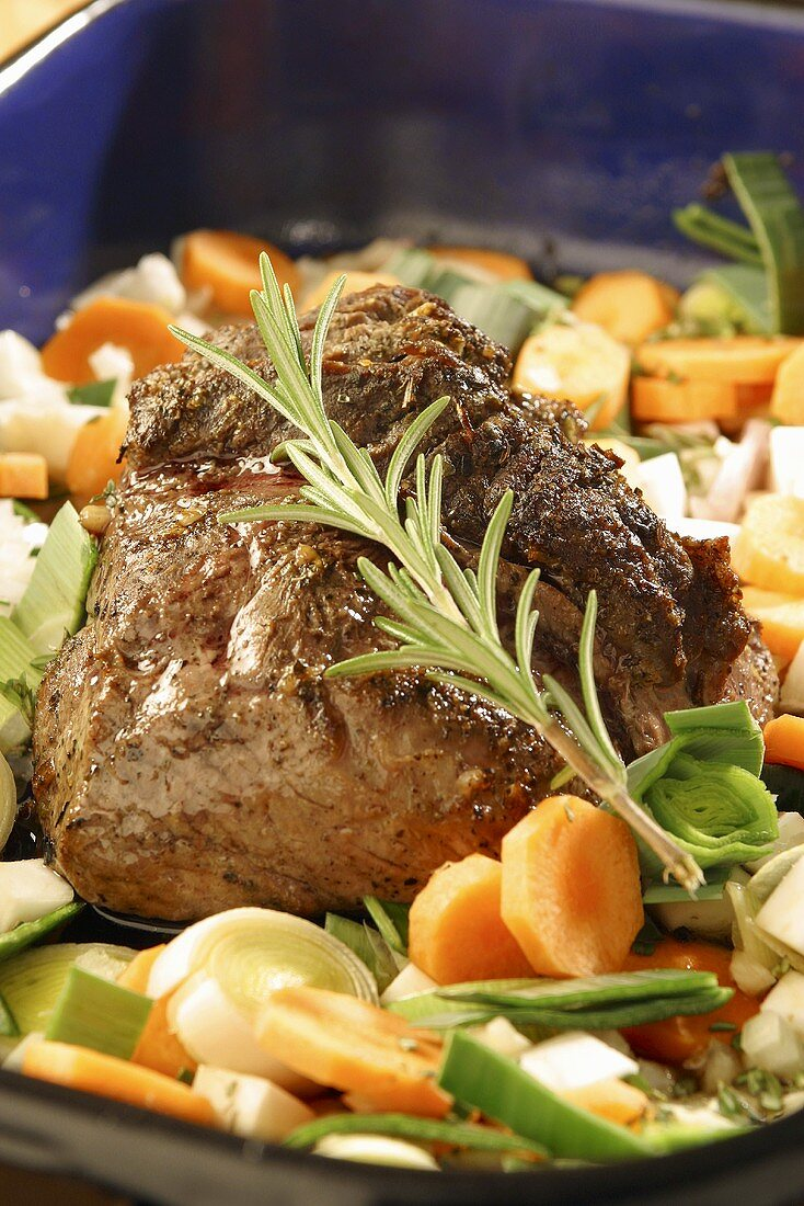Roast Bavarian wild boar with vegetables and rosemary