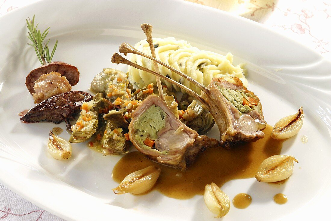 Young goat on a bed of artichokes with truffled mashed potatoes
