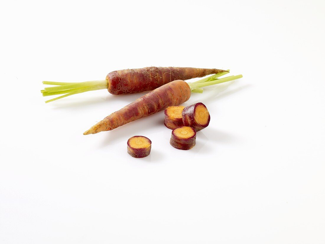 Purple carrots, whole and sliced