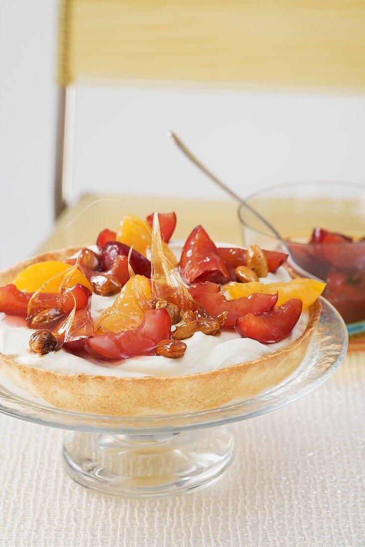 Yogurt tart with cinnamon plums and roasted nuts