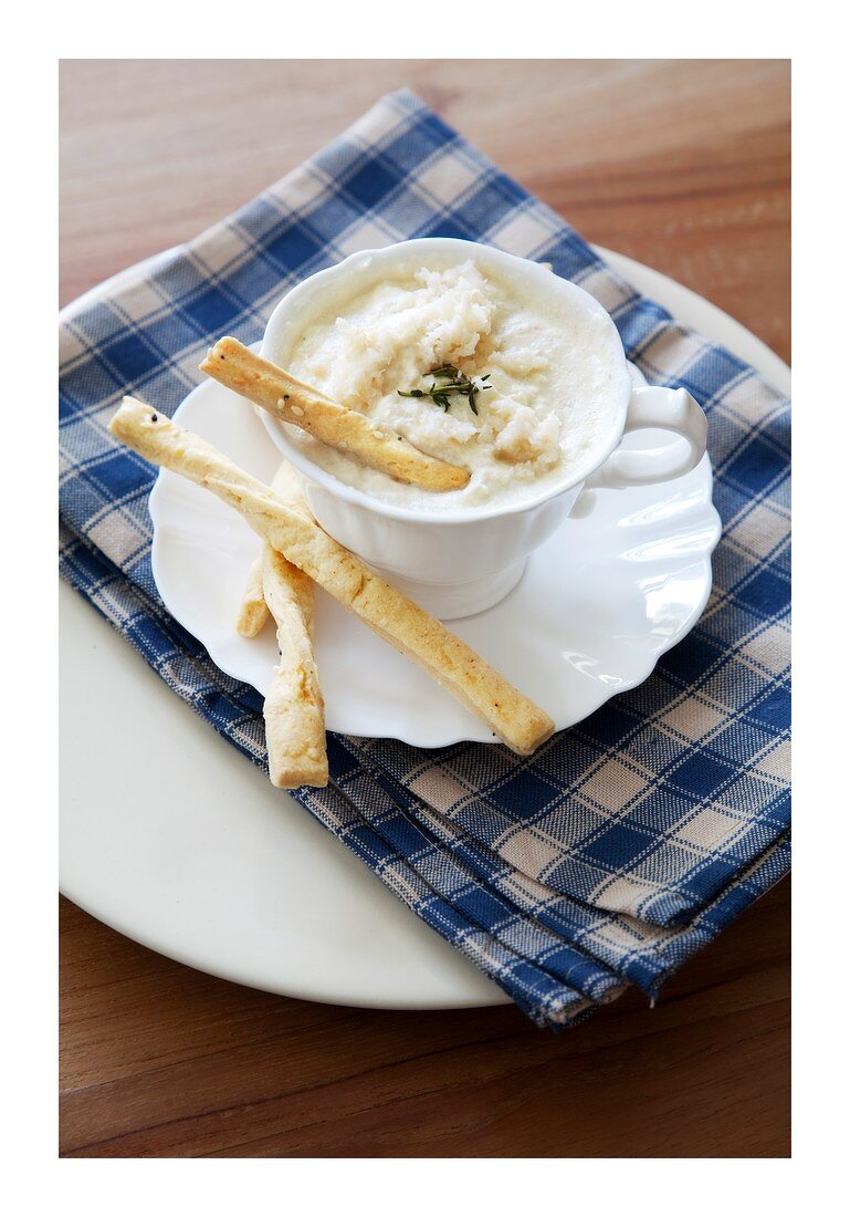 A warm cheese dip with crab meat