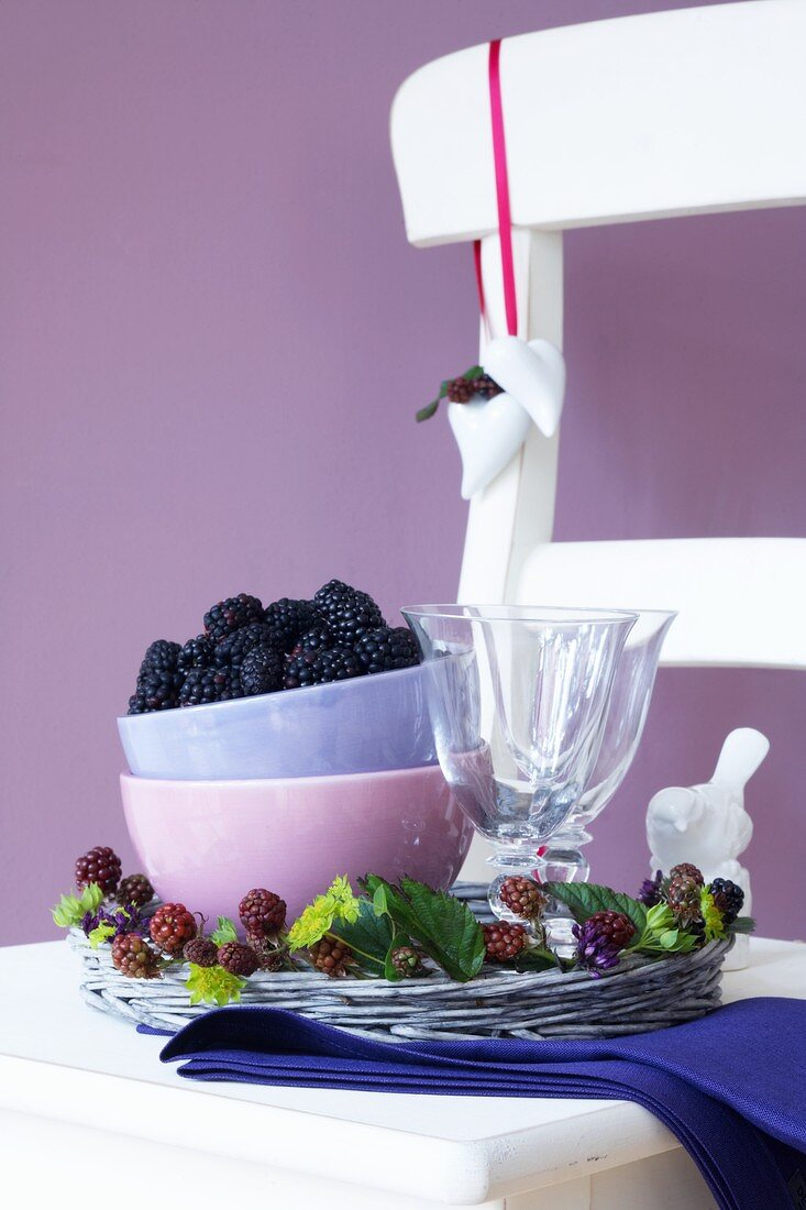A wicker tray with blackberries