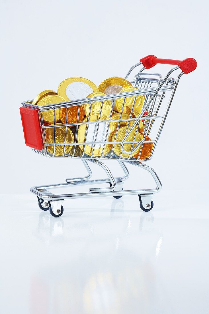 A shopping trolley filled with chocolate euro coins