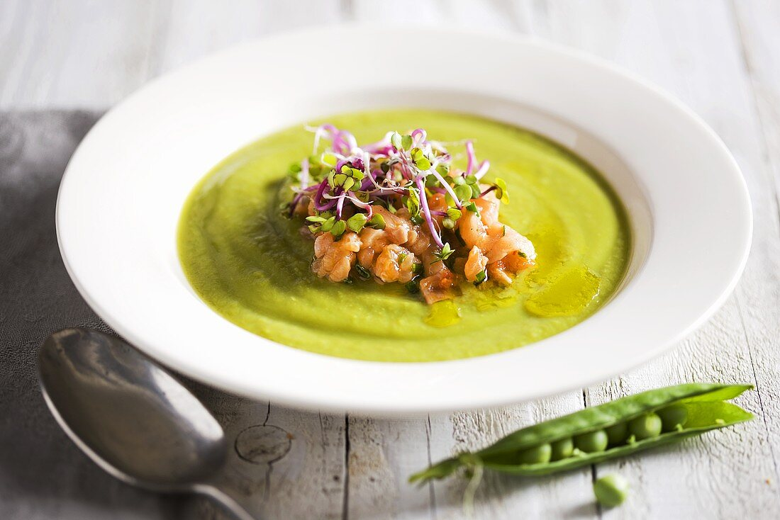 Pea soup with bean sprouts and salmon
