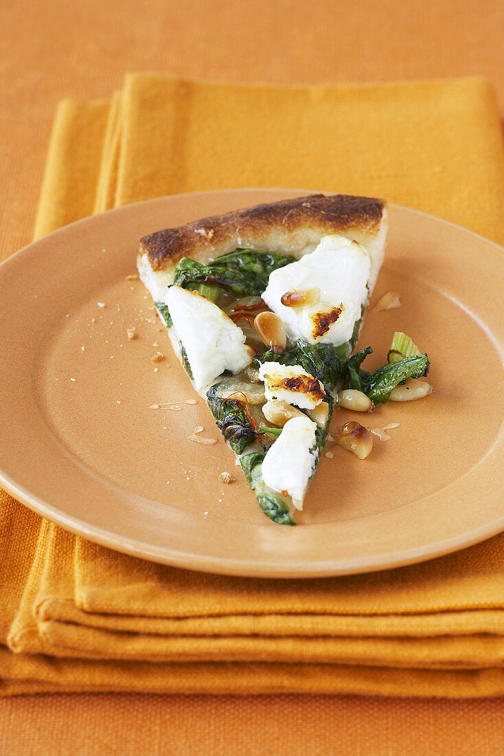 A slice of spinach and goat's cheese pizza