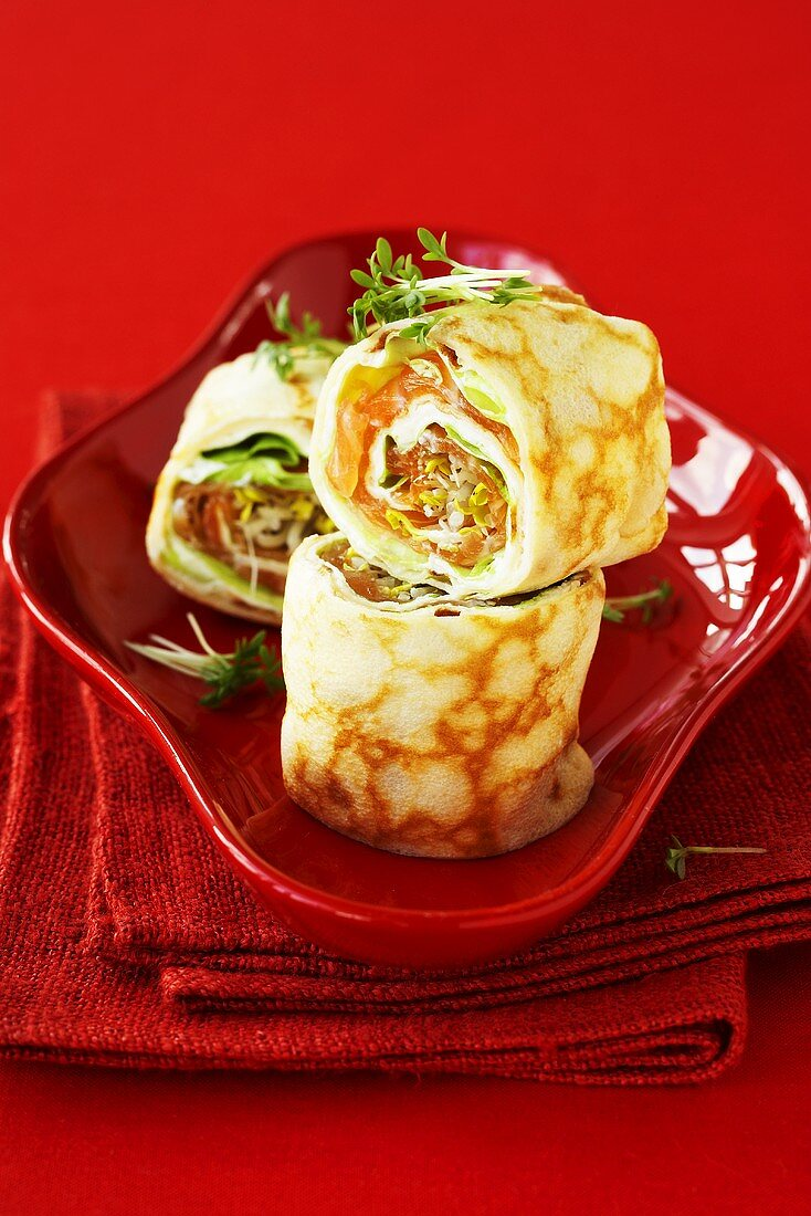 Pancake rolls filled with smoked salmon and cream cheese