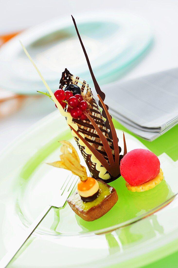 Strawberry ice & small cake with woodruff mousse, chocolate decoration