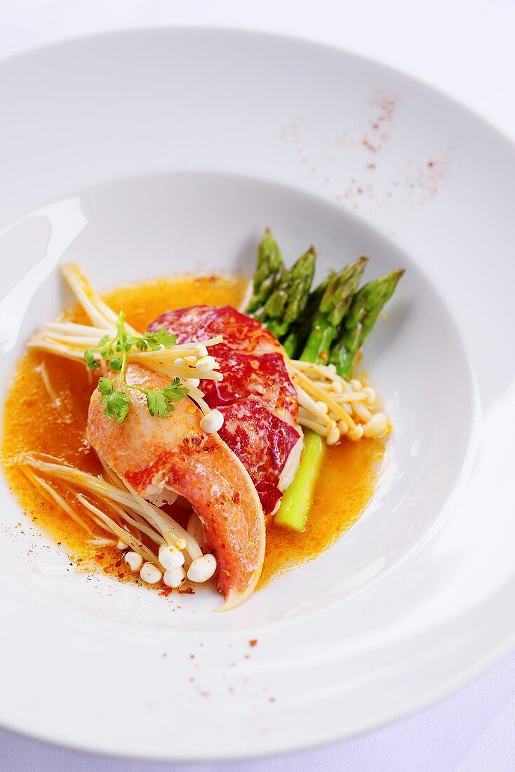 Lobster in coconut curry sauce, green asparagus & enoki mushrooms