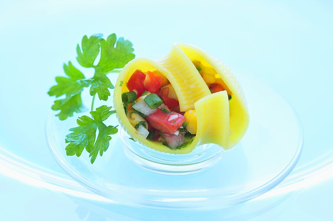 Lumaconi filled with tomato and sweetcorn salad