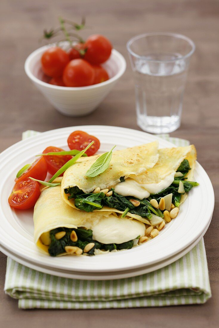 Pancakes filled with spinach, mozzarella and pine nuts