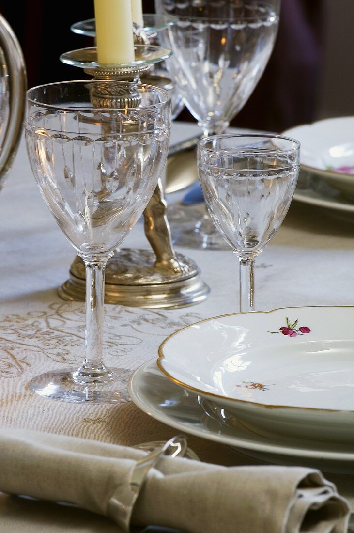 Elegant place-setting with crystal glasses