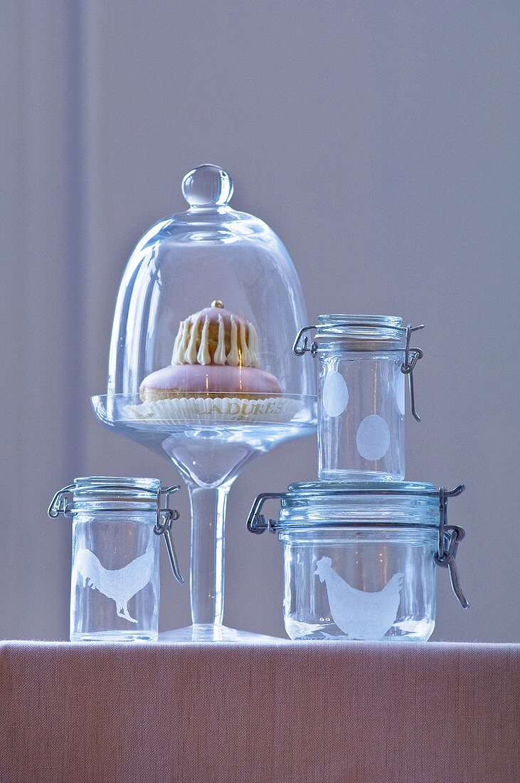 Easter cake under glass dome & preserving jars with Easter motifs