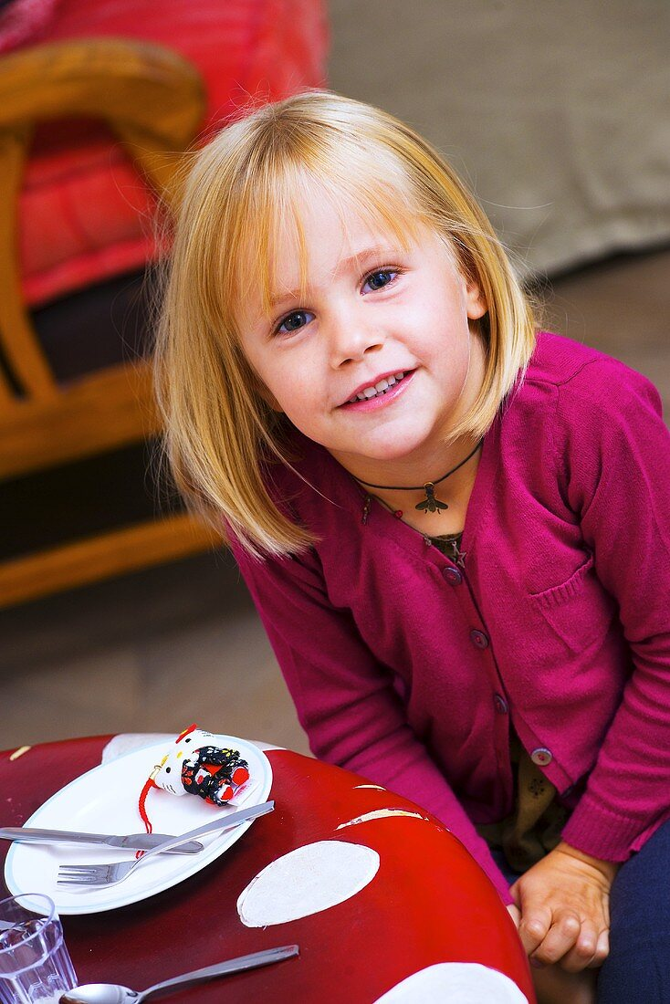 Little girl at dining table