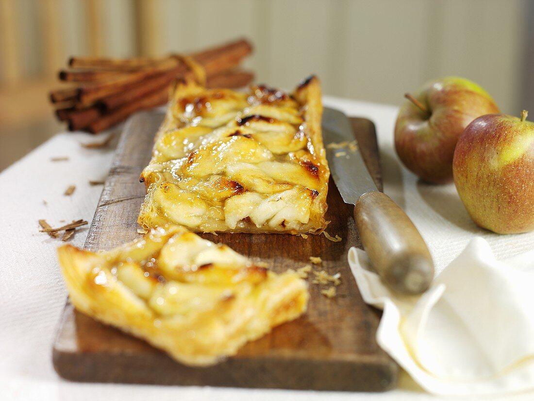 Rustic apple pie on chopping board