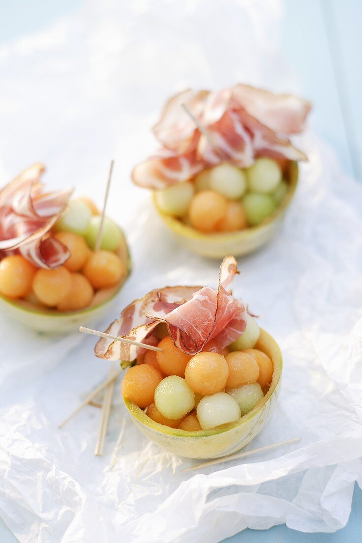 Charentais melon balls with ham in hollowed-out melons