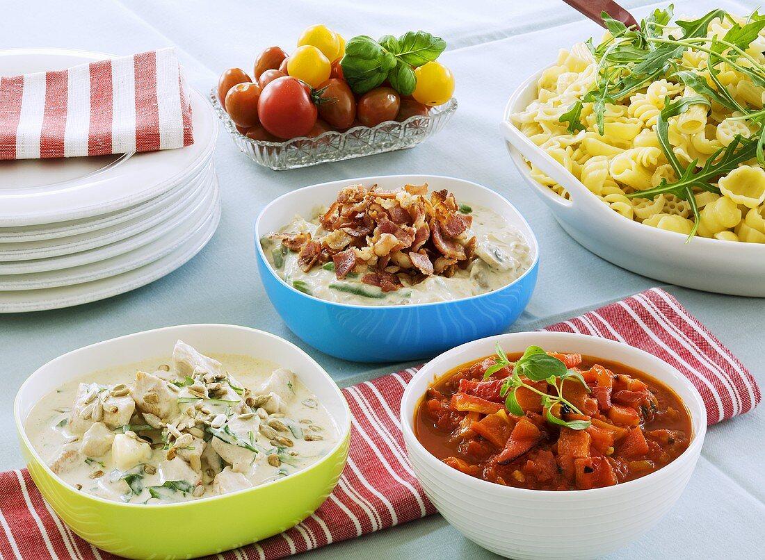 Buffet of pasta salad and various Swedish dishes