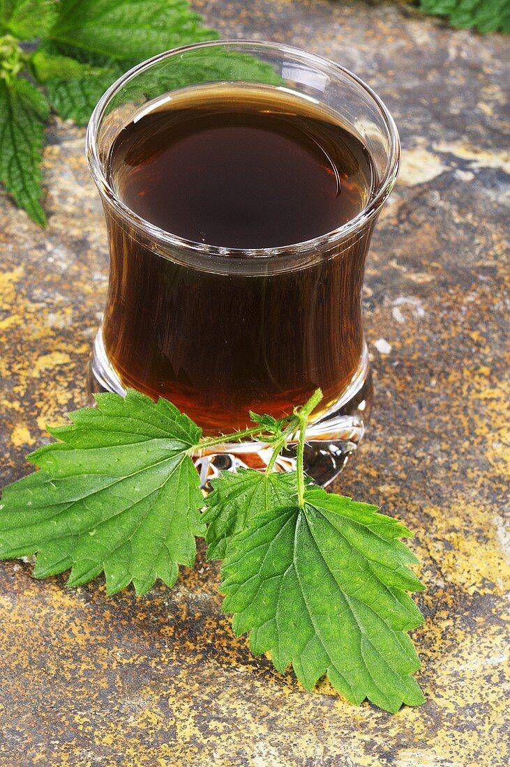 Nettle juice and fresh nettle leaves