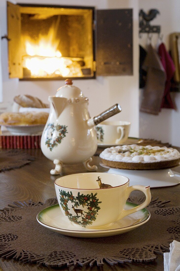 Tea things and cake on table in an Alpine chalet
