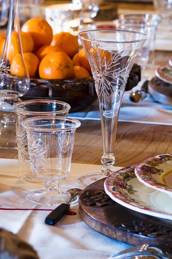 Laid table with mandarin oranges in an Alpine chalet