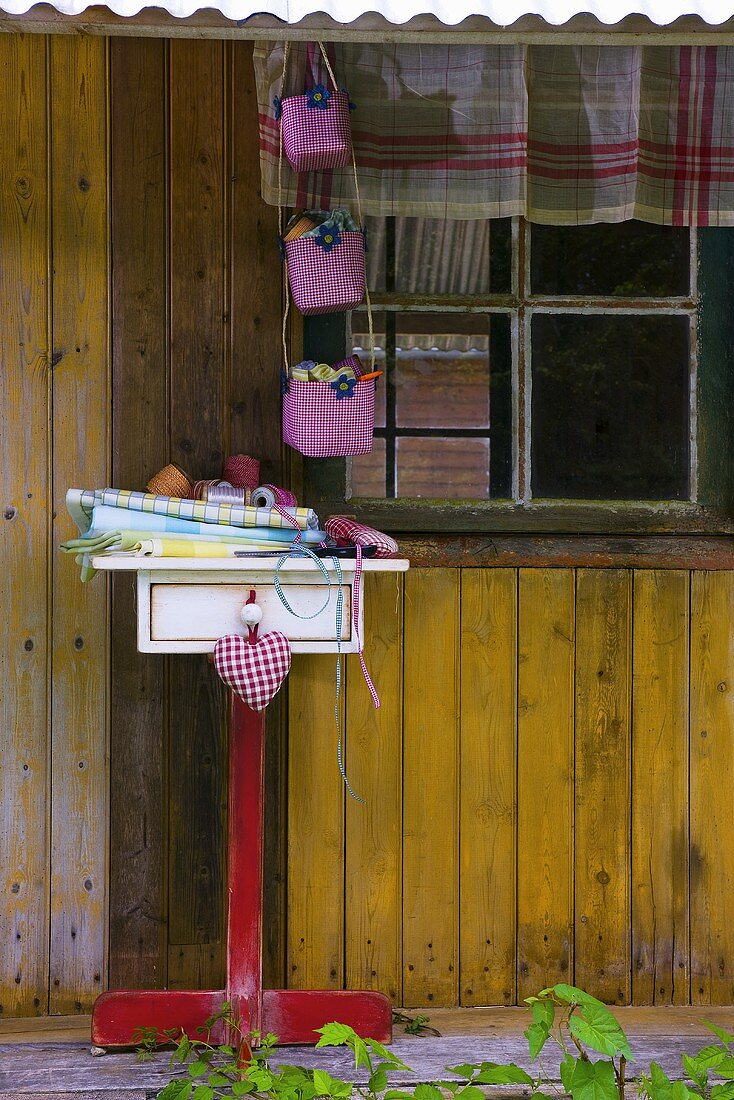 Table linen on stand outside summerhouse