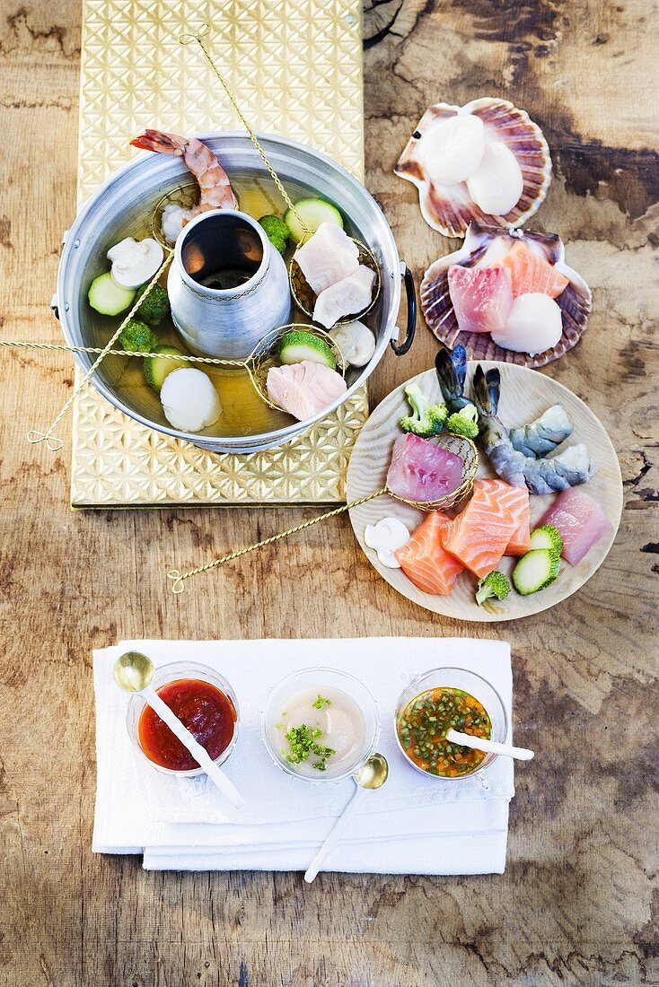 Fish fondue with sauces
