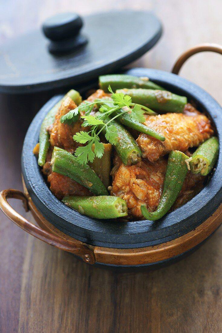 Frango com quiabo (chicken with okra, Brazil) in soapstone dish