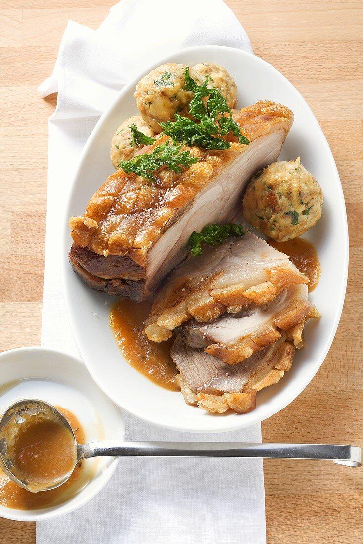 Roast pork with crackling with beer gravy & pretzel dumplings