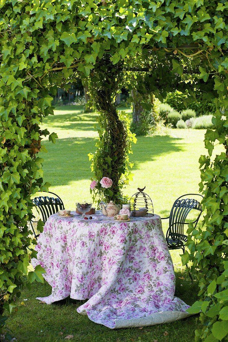 Romantic table in castle grounds (Château de la Verrerie, France)