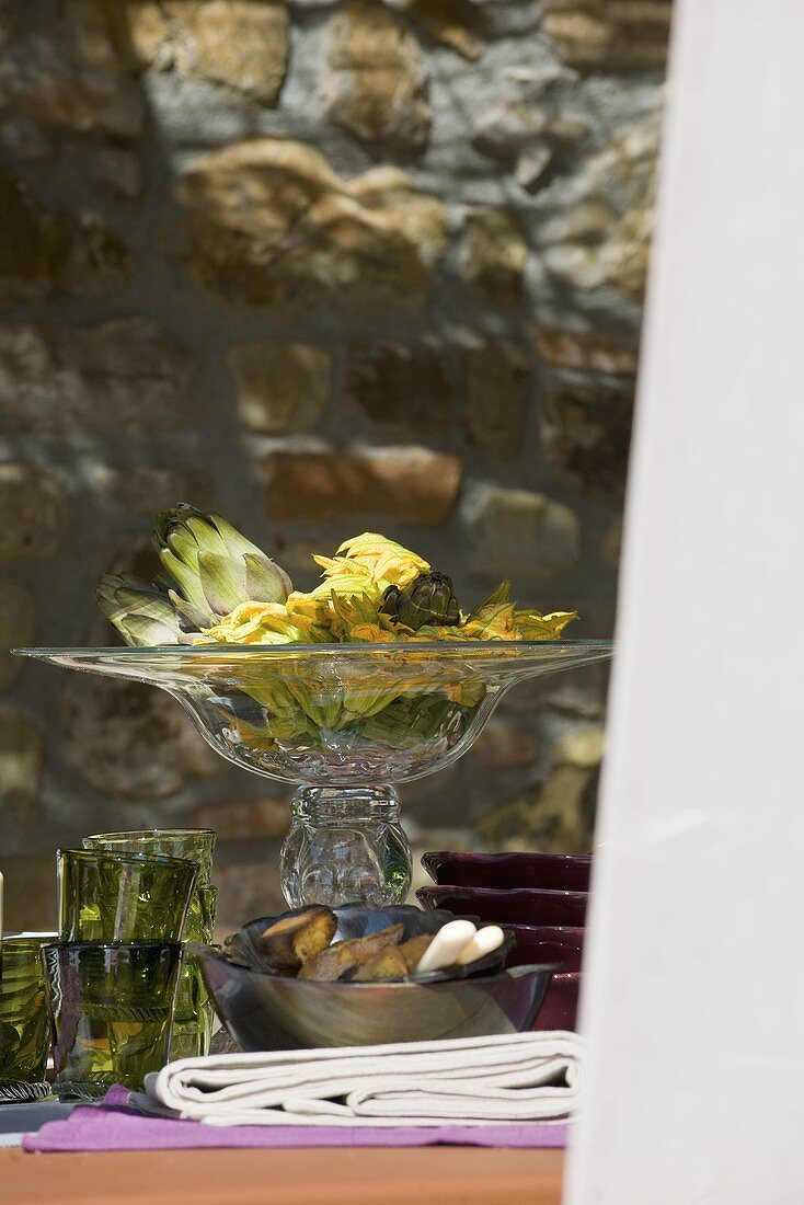 Artichokes and courgette flowers (table decoration, Italy)