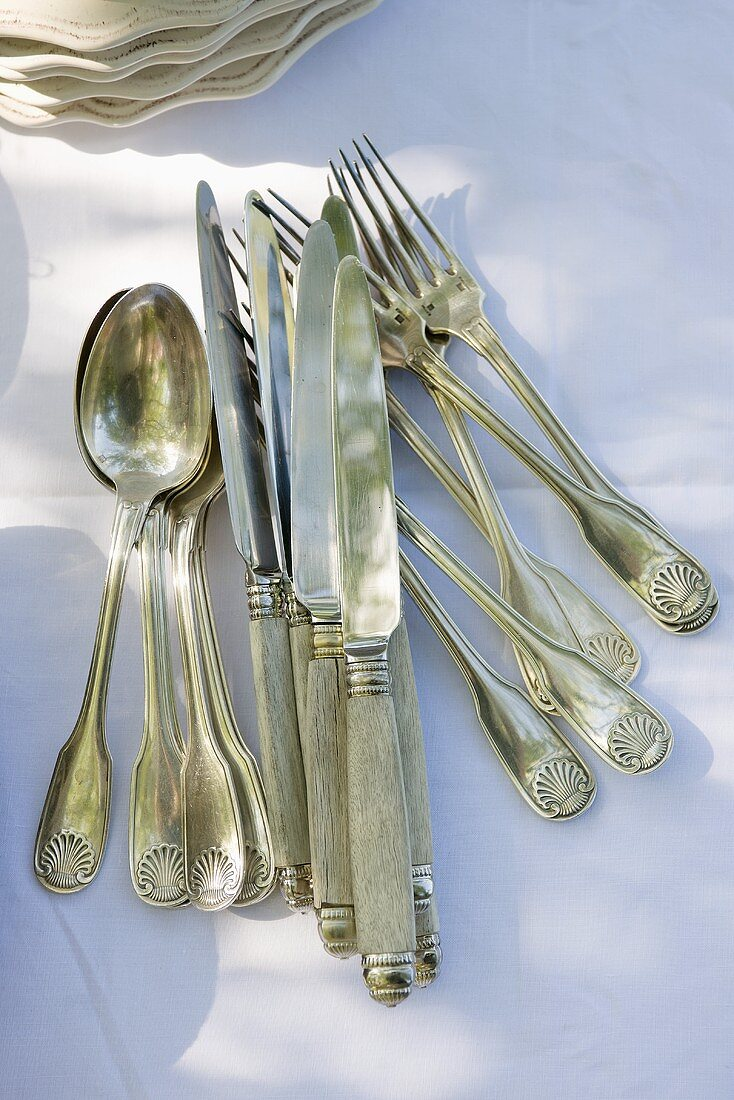 Antique silver cutlery on table