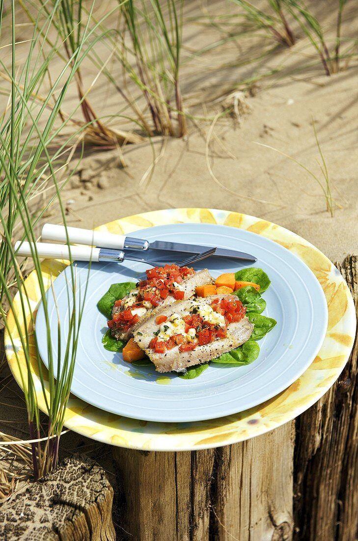 Baked sardines with cheese and tomato stuffing
