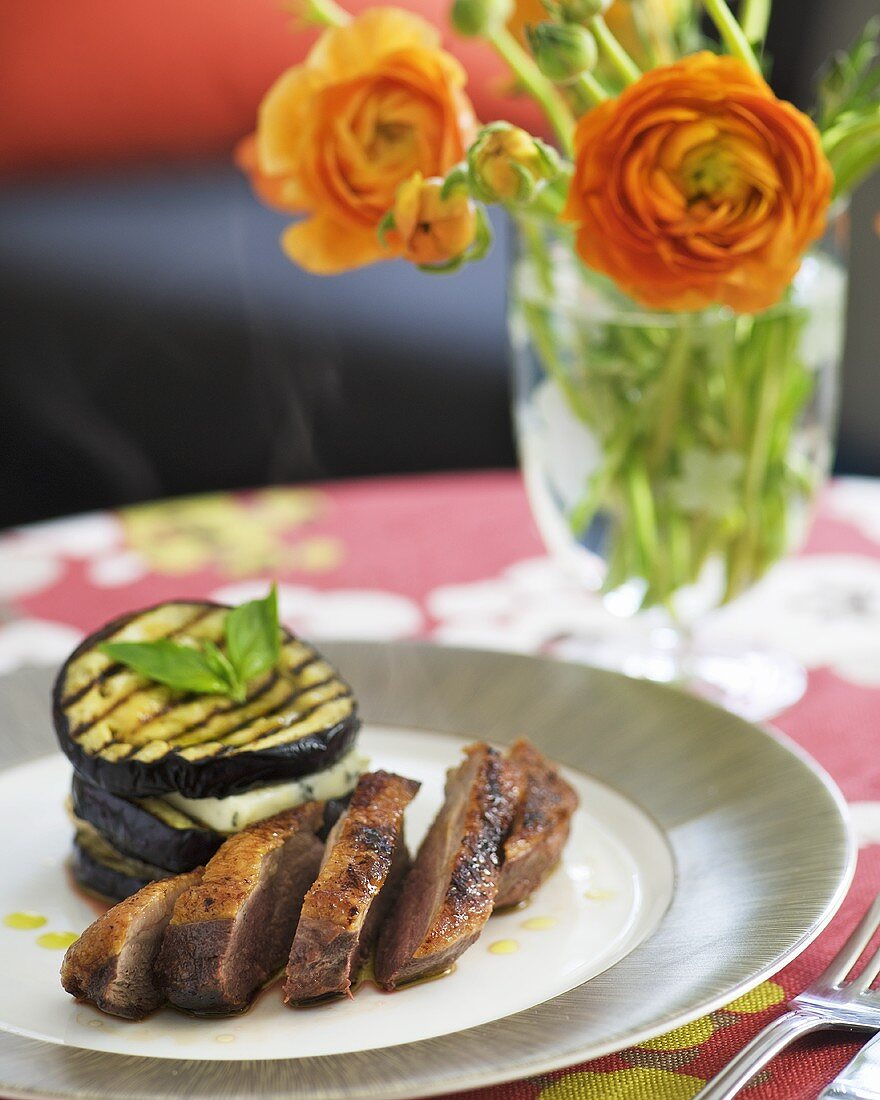 Duck breast with aubergine and Dolcelatte tower
