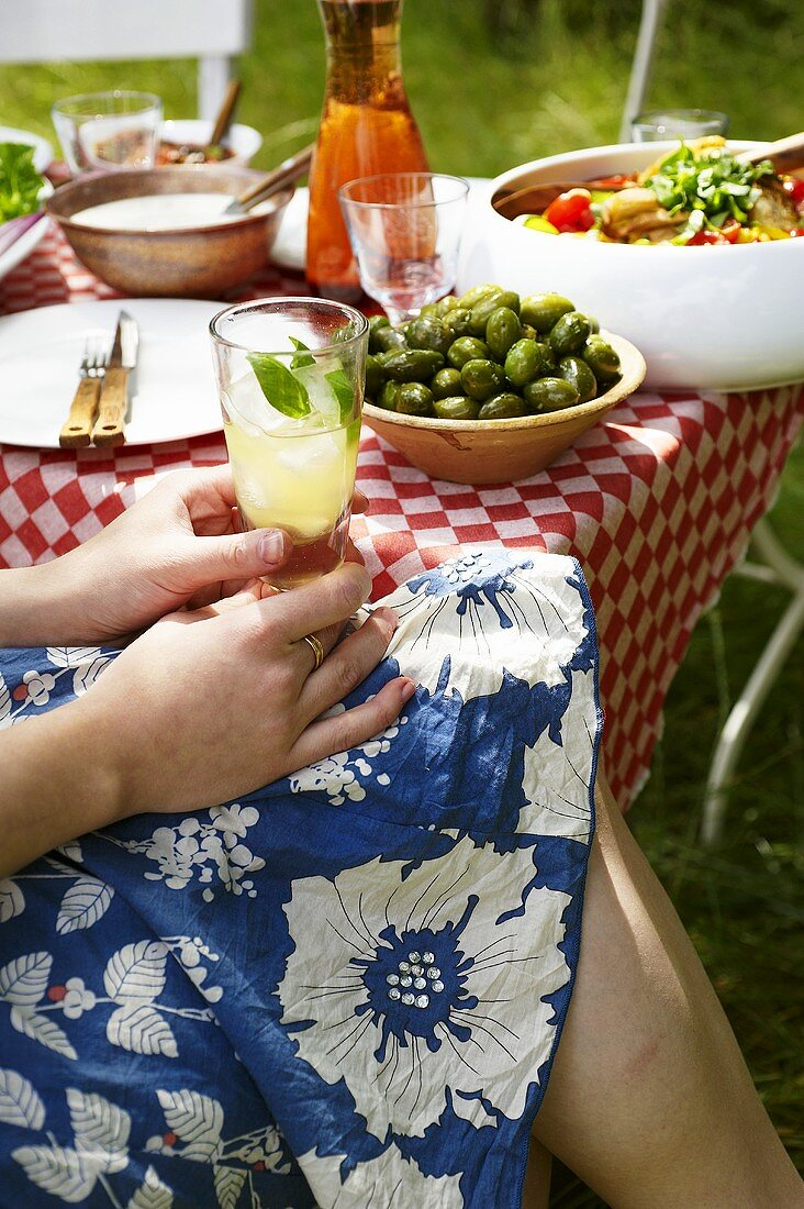 Woman with Orangina cocktail at Italian barbecue
