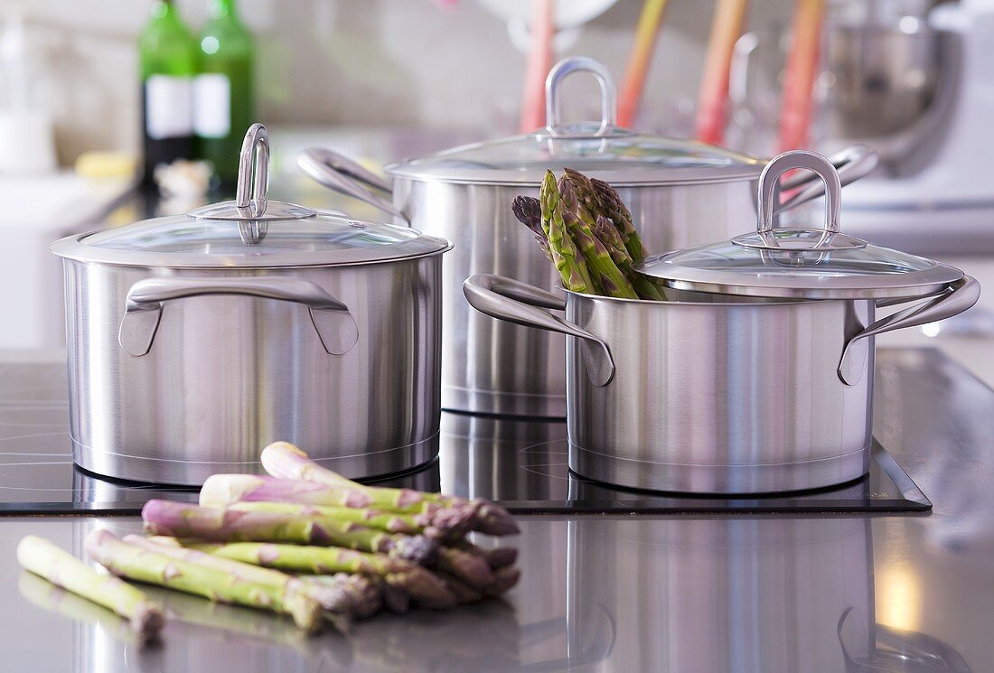 Pans and green asparagus