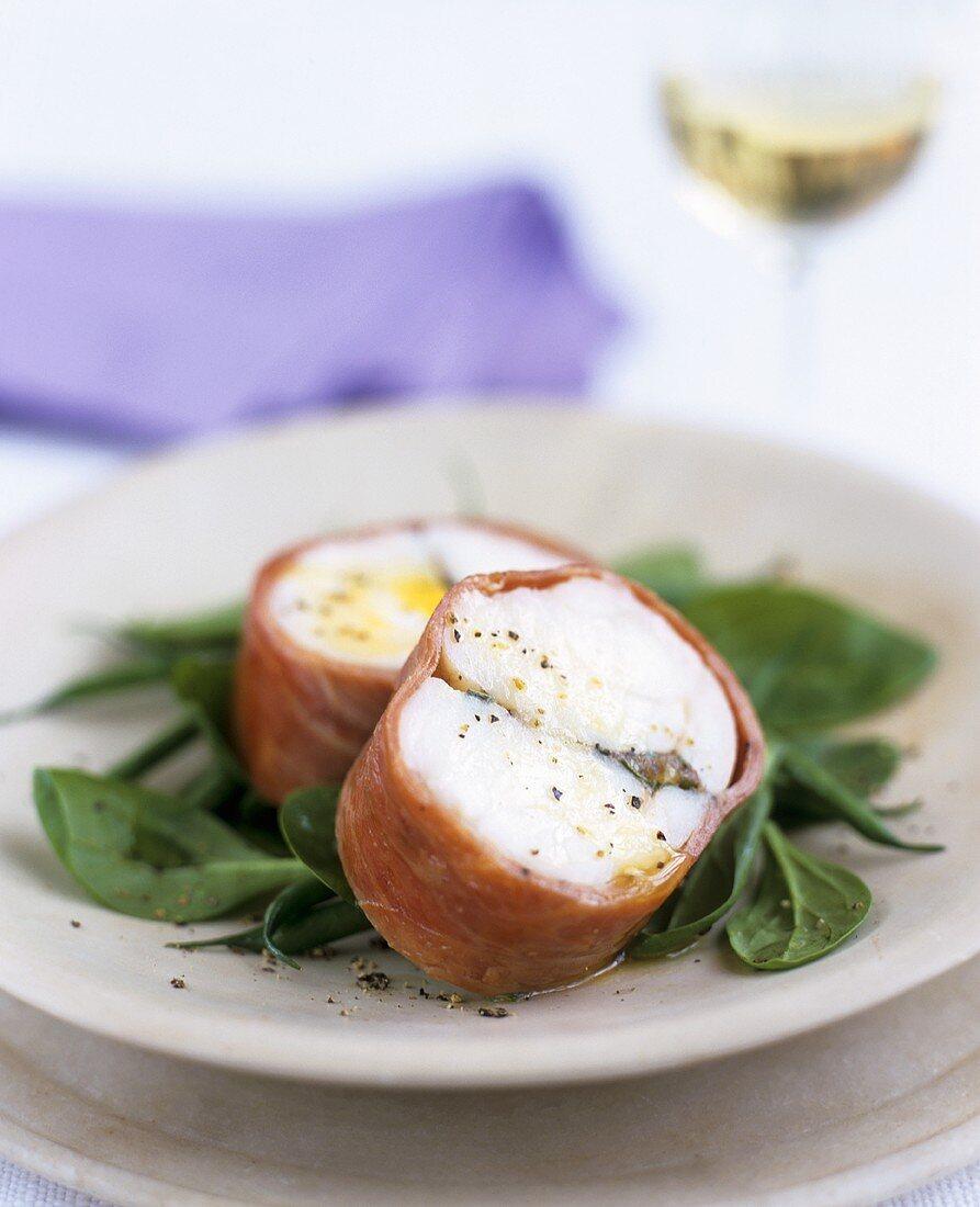 Monkfish wrapped in Parma ham on corn salad