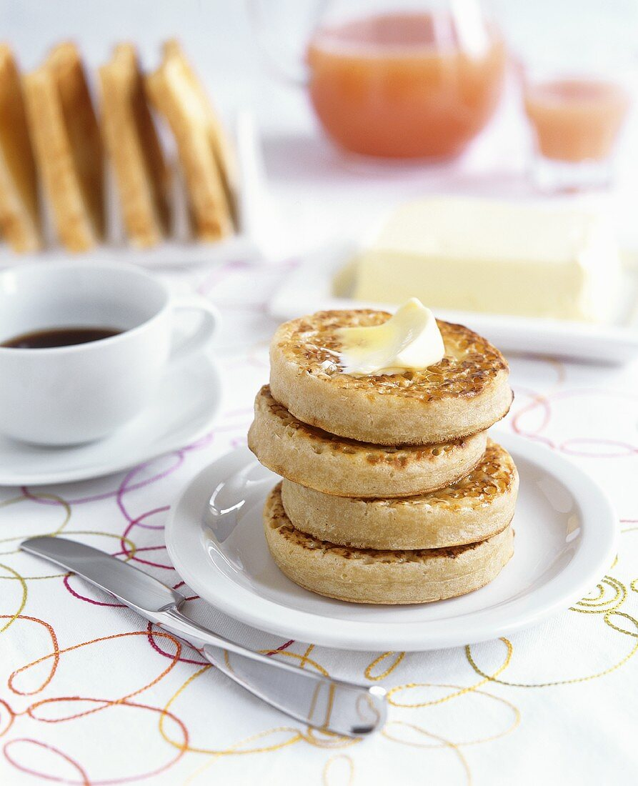 Toasted crumpets (English yeast cakes) for breakfast