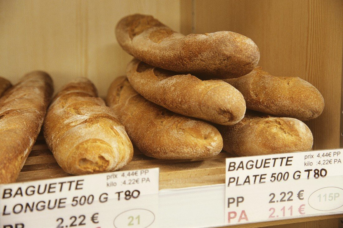 Baguettes with prices in a baker's shop