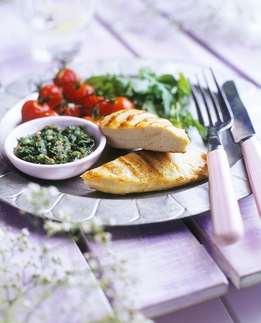 Grilled chicken breast with vegetables and caper tapenade