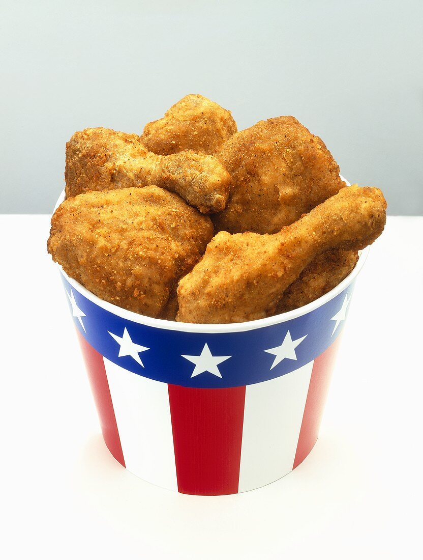 Breaded chicken pieces in paper cup with US colours