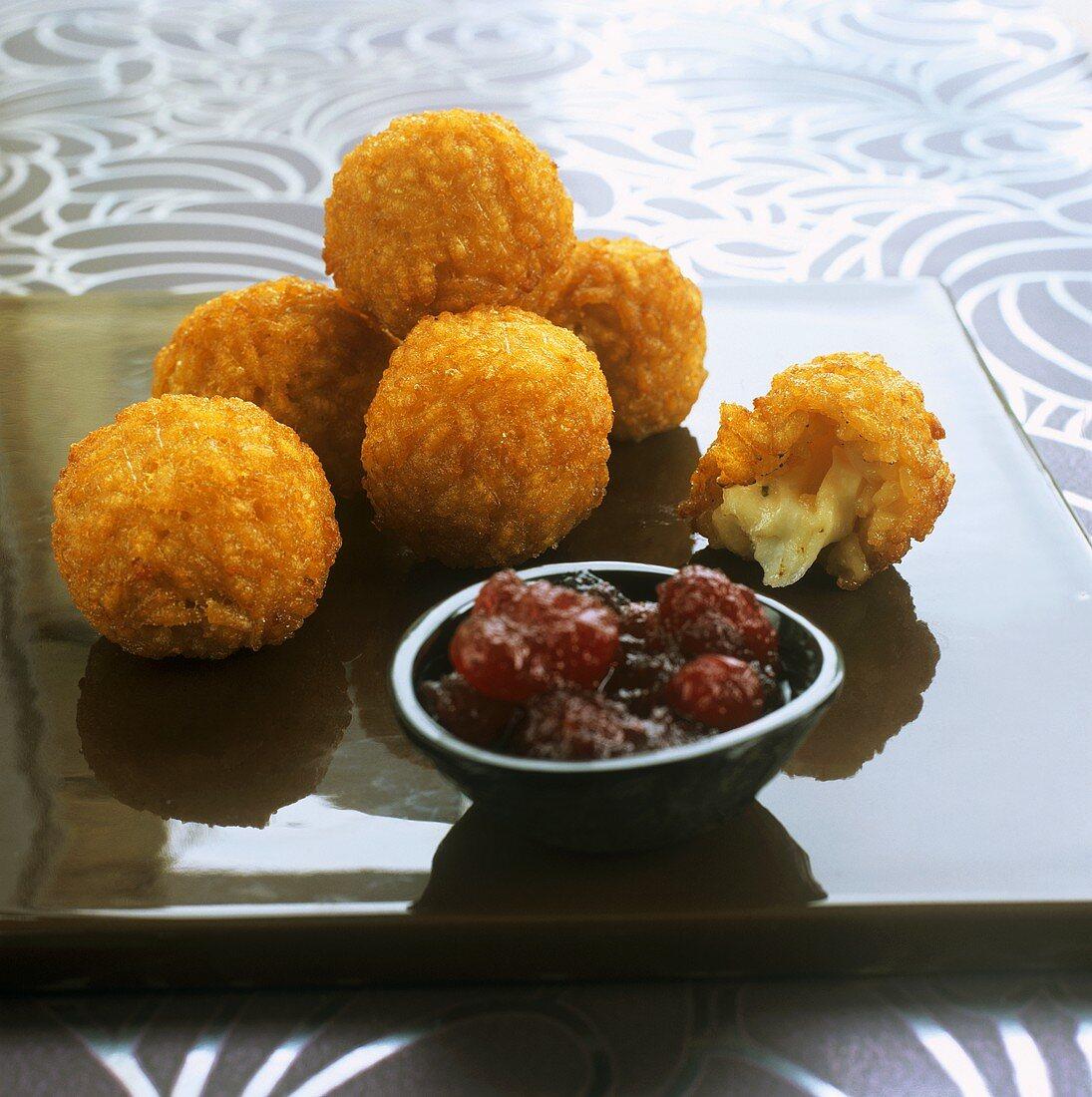 Deep-fried mozzarella risotto balls with cranberry sauce